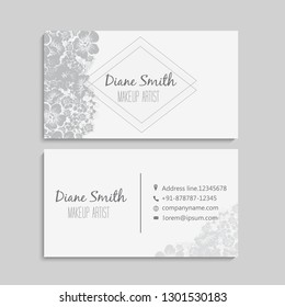 illustration of front and back of corporate business card with floral design