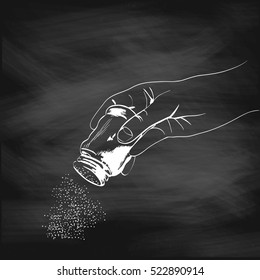 illustration of a hand with the salt shaker painted chalk on a blackboard