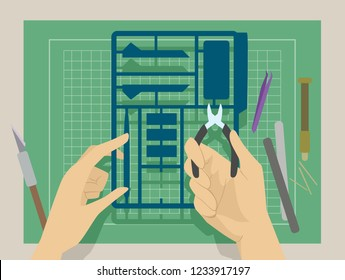Illustration of Hands Holding a Plastic Model and a Cutter