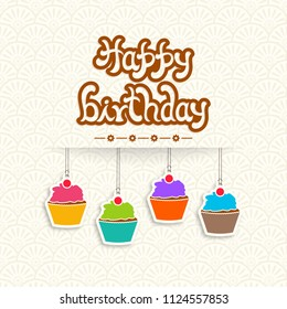 Illustration of happy birthday with beautiful calligraphy and hanging cupcakes.