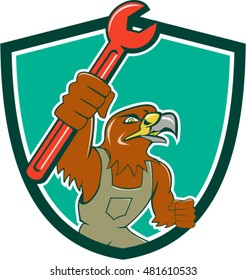 Illustration of a hawk mechanic raising up pipe spanner set inside shield crest on isolated background done in cartoon style.