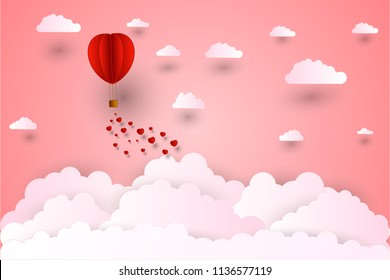 illustration of love and valentine day,Origami made hot air balloon flying on the sky with heart float on the sky.paper art and digital craft design style.