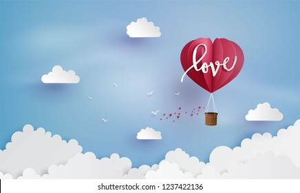 illustration of love and valentine day,Origami made hot air balloon flying on the sky with heart .paper art style.