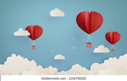 illustration of love and valentine day,Origami made hot air balloon flying on the sky with heart paper art 3d  from digital craft.