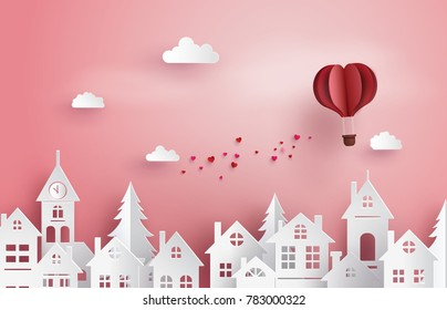 Illustration of Love and Valentine Day,Paper hot air balloon heart shape floating on the sky  over village , Paper art and digital craft style.