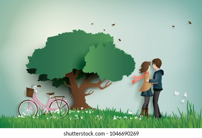 Illustration of love and valentine's Day,  with couple standing hugging on a grass field with pink bicycle and big tree.paper art  style.