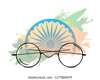 Illustration Of Mahatma Gandhi Spectacles On Indian Flag Color Background With Ashoka Chakra Design. 2nd Of October.