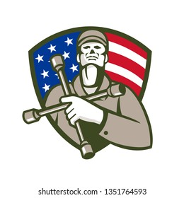Illustration of a mechanic worker holding tire wrench, 4-way lug wrench, or tyre iron on chest looking up set in shield crest with american usa flag stars and stripes in background done retro style.