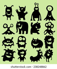 Illustration set of cute little smiling monsters in black silhouettes