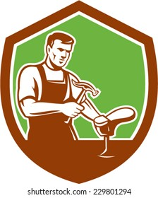 Illustration of a shoemaker cobbler shoe repair with hammer and shoe working set inside shield crest on isolated background done in retro style.