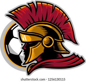 The illustration shows a spartan soldier set against the background of a soccer ball. The brave warrior wears a spartan helmet with feathers and a red mantle.