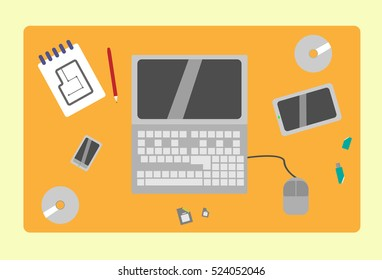 illustration of a top view of the workplace which is a laptop, disks, blonot to draw the circuit and other electronic gadgets,style flat.