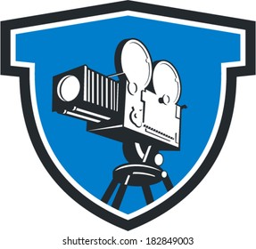 Illustration of a vintage movie film motion-picture camera set inside shield crest shape done in retro style.