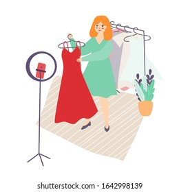 Illustration of a young Slavic blogger girl with red hair shows dresses clothes on video, photo. A girl stylist shoots on the camera phone for a blog. home vlog.flat style, vector