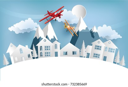 illustrations of airplanes crossing homes and snow hills in winter. design paper art and handicraft