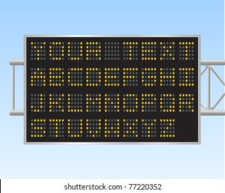 Image of an electronic billboard against a blue sky background.