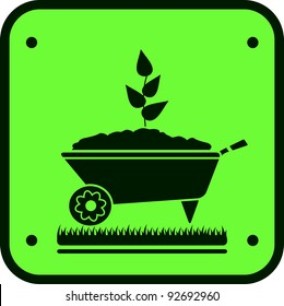 image garden sign with wheelbarrow and green sprout