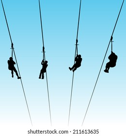 An image of people in a zip line race.