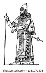 The image shows the Assyrian king. He is the god of the Assyrian state. He holds the long stick and the second-hand sword. He has a crown on his head, vintage line drawing or engraving illustration.