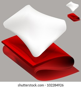 An image of a soft white pillow and a red folded blanket.