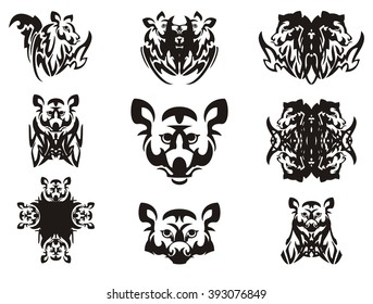 Imaginary animal head and symbols from it. Tribal imaginary head of an animal with wings, the head of a raccoon, a cross and other double symbols
