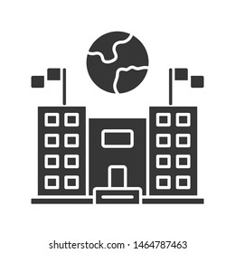 Immigration center glyph icon. Embassy and consulate building. Administrative governmental structure. Earth globe over public building. Silhouette symbol. Negative space. Vector isolated illustration