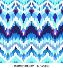 Impressive fashion print. Modern look of ethnic indian ornaments. Seamless pattern in bright blue colors. Tie dye effect and boho chic style. Creative hippies textile.