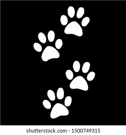 Imprint of white paws on a black background. Vector graphics.