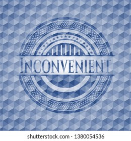 Inconvenient blue emblem or badge with abstract geometric pattern background.