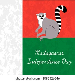 Independence Day in Madagascar. 26 June. Concept of a national holiday. Flag of Madagascar, lemur, grunge texture