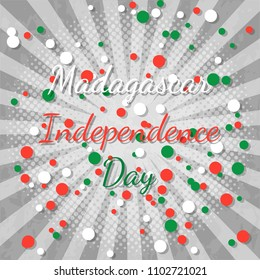 Independence Day in Madagascar. 26 June. Concept of a national holiday. Rays from the center. Gray background, grunge texture. Circles of flag colors - white, red, green