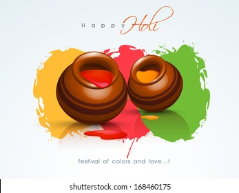Indian color festival Holi concept with traditional mud pots with full of colors on grungy colors background.