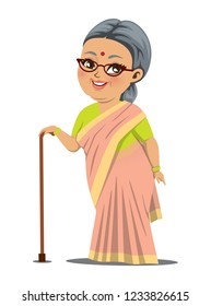 An Indian fat old happy grandmother wearing a saree is standing with a stick in her hand for support.