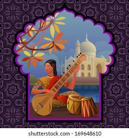 Indian girl playing on sitar near Taj Mahal