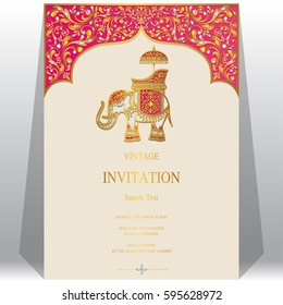 Indian Invitation card templates with gold Elephant patterned and crystals on paper color.