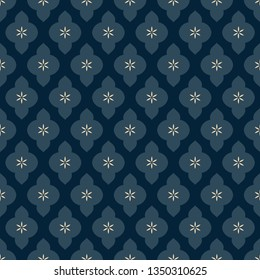 Indian paisley pattern folk floral motif. Arrangement of tiny flowers in simple geometric shapes. Oriental ornament navy blue background. Elegant print block for apparel textile, wear fabric, garment.