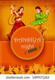 Indian people dancing Garba on Dandiya Night celebrating Navratri festival of India