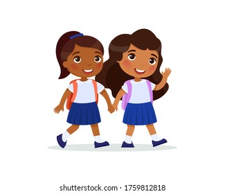 Indian schoolgirls going to school flat vector illustration. Couple pupils in uniform holding hands isolated cartoon characters. Two happy elementary school students with backpacks waving hand