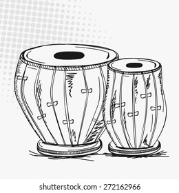 Indian traditional musical instrument tabla (drums) on vintage abstract background.