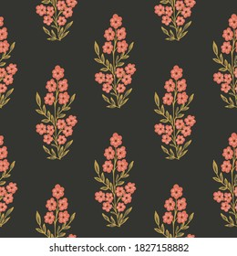 Indian wildflower motif seamless vector pattern. Little flowers a flowering tree in an Indian style. Coral and green on black . Great for home décor, fabric, wallpaper, stationery, design projects.
