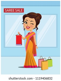 Indian woman in a saree with shopping bags in a shop having a saree sale