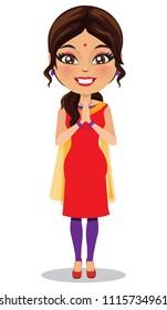 Indian woman wearing a salwar kameez suit in a namaste pose
