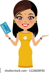 Indian woman wearing a salwar kameez is holding a credit/ debit card in her hand and smiling