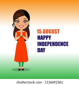 An Indian woman wearing a salwar kameez is in a namaste pose and is wishing everyone a happy independence say of India. She is standing in front of a flag colored background.