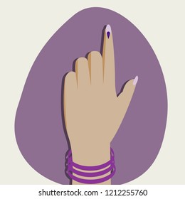 An Indian woman's hand showing voting mark