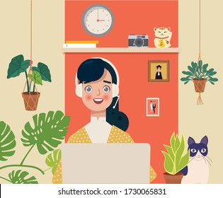 Indian young business woman working in front of a computer while sitting at home. Home office, remote work, freelance, peaceful atmosphere with a laptop.