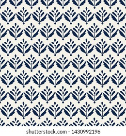 Indigo dye all over seamless woodblock printed floral pattern. Traditional oriental Indian ethnic ornament, navy blue on ecru  background. Textile design.