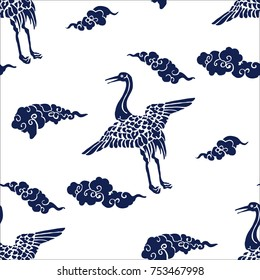 Indigo dye seamless  stencil pattern, Japanese traditional motif with cranes and clouds. Navy blue on ecru background. Textile design.