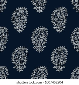 Indigo dye woodblock printed seamless paisley pattern. Traditional oriental ethnic ornament of India, ecru on navy blue background. Textile design.
