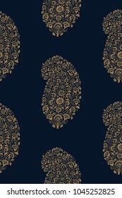 Indigo dye woodblock printed seamless paisley pattern. Traditional oriental ethnic ornament of India, gold on navy blue background. Textile design.